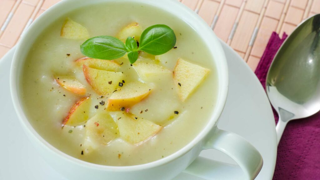 Apple Ash Gurd Soup in a white cup